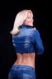 Ragazza sorridente in blue jeans Immagini Stock Libere da Diritti