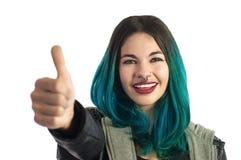Ragazza sorridente che mostra l'un dito, contante il segno della mano Fotografia Stock
