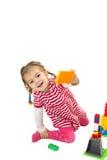 Ragazza sorridente con i giocattoli Immagini Stock Libere da Diritti