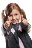 Ragazza sorridente con i pollici in su Fotografia Stock Libera da Diritti
