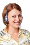 Ragazza sorridente con i trasduttori auricolari e un microfono Fotografia Stock