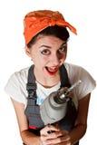 Ragazza sorridente con il trivello Fotografia Stock