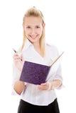 Ragazza sorridente con la penna ed il copybook Fotografia Stock Libera da Diritti