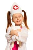 Ragazza sorridente con le trecce vestite come dentista Fotografie Stock Libere da Diritti
