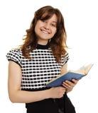 Ragazza sorridente con un libro isolato su bianco Fotografie Stock