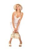 Ragazza sorridente con un sacchetto Fotografie Stock Libere da Diritti