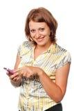 Ragazza sorridente con un telefono mobile Immagini Stock Libere da Diritti