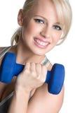 Ragazza sorridente di allenamento Immagine Stock