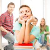 Ragazza sorridente felice dello studente con i libri alla scuola Fotografia Stock Libera da Diritti