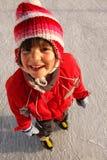 Ragazza sorridente sui pattini di ghiaccio Immagine Stock Libera da Diritti