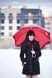 Ragazza sotto l'ombrello immagine stock libera da diritti