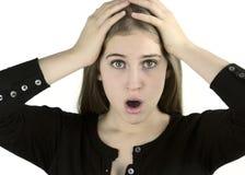 Ragazza spaventata con le mani sulla testa Immagini Stock