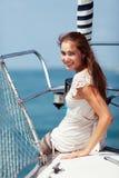 Ragazza su un yacht Immagini Stock Libere da Diritti