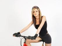 Ragazza su una bici Fotografie Stock