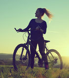 Ragazza su una bicicletta Fotografia Stock