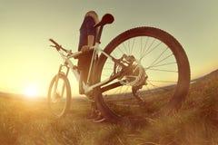 Ragazza su una bicicletta Immagine Stock