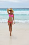 Ragazza su una spiaggia Fotografia Stock