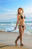 Ragazza su una spiaggia Fotografia Stock Libera da Diritti