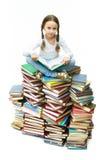 Ragazza sui libri Fotografia Stock