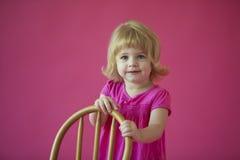 Ragazza sul colore rosa Immagine Stock Libera da Diritti
