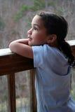 Ragazza sul portico Fotografia Stock