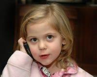 Ragazza sul telefono Immagini Stock