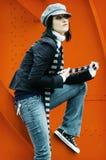 Ragazza sull'arancio fotografie stock