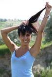 Ragazza sulla mano e sui capelli Fotografia Stock