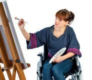 Ragazza sulla sedia a rotelle immagine stock