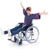 Ragazza sulla sedia a rotelle fotografie stock
