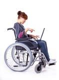 Ragazza sulla sedia a rotelle immagini stock libere da diritti