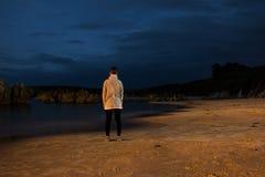 Ragazza sulla spiaggia, effetto del fantasma immagine stock