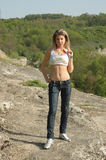 Ragazza sulle rocce Fotografia Stock