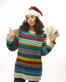 Ragazza sveglia in cappello rosso di Santa con soldi isolati Fotografia Stock Libera da Diritti