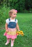 Ragazza sveglia con i fiori Fotografia Stock