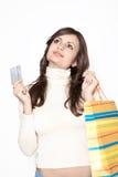 Ragazza sveglia con i sacchetti di acquisto e la carta di credito Fotografia Stock Libera da Diritti