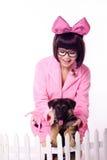 Ragazza sveglia con il cane del bambino Fotografia Stock