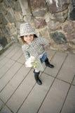 Ragazza sveglia con il fiore Fotografia Stock