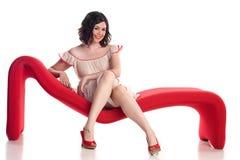 Ragazza sveglia nella posa del perno-in su Fotografia Stock