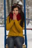 Ragazza sveglia sul campo da giuoco nell'inverno Fotografie Stock Libere da Diritti