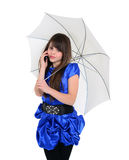 Ragazza sveglia in vestito blu che parla dal telefono Immagini Stock Libere da Diritti