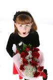 Ragazza sveglia in vestito con le rose rosse fotografia stock
