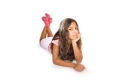 Ragazza teenager che si trova sul pensiero del pavimento Immagine Stock Libera da Diritti