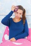 Ragazza teenager con l'emicrania Immagine Stock