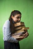 Ragazza teenager con la pila di libri Immagine Stock Libera da Diritti