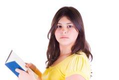 Ragazza teenager con un libro Fotografia Stock Libera da Diritti