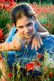 Ragazza teenager del ritratto con il papavero Fotografia Stock Libera da Diritti