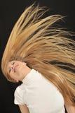 Ragazza teenager di età dei capelli lunghi biondi sexy Fotografie Stock