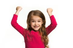 Ragazza teenager di successo felice che celebra essendo un vincitore Immagine energetica dinamica del modello femminile Fotografie Stock Libere da Diritti