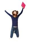 Ragazza teenager felice di salto dell'allievo Immagini Stock